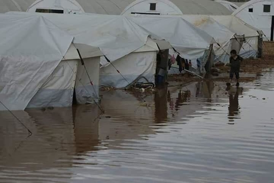 Picture of boy in flooded camp